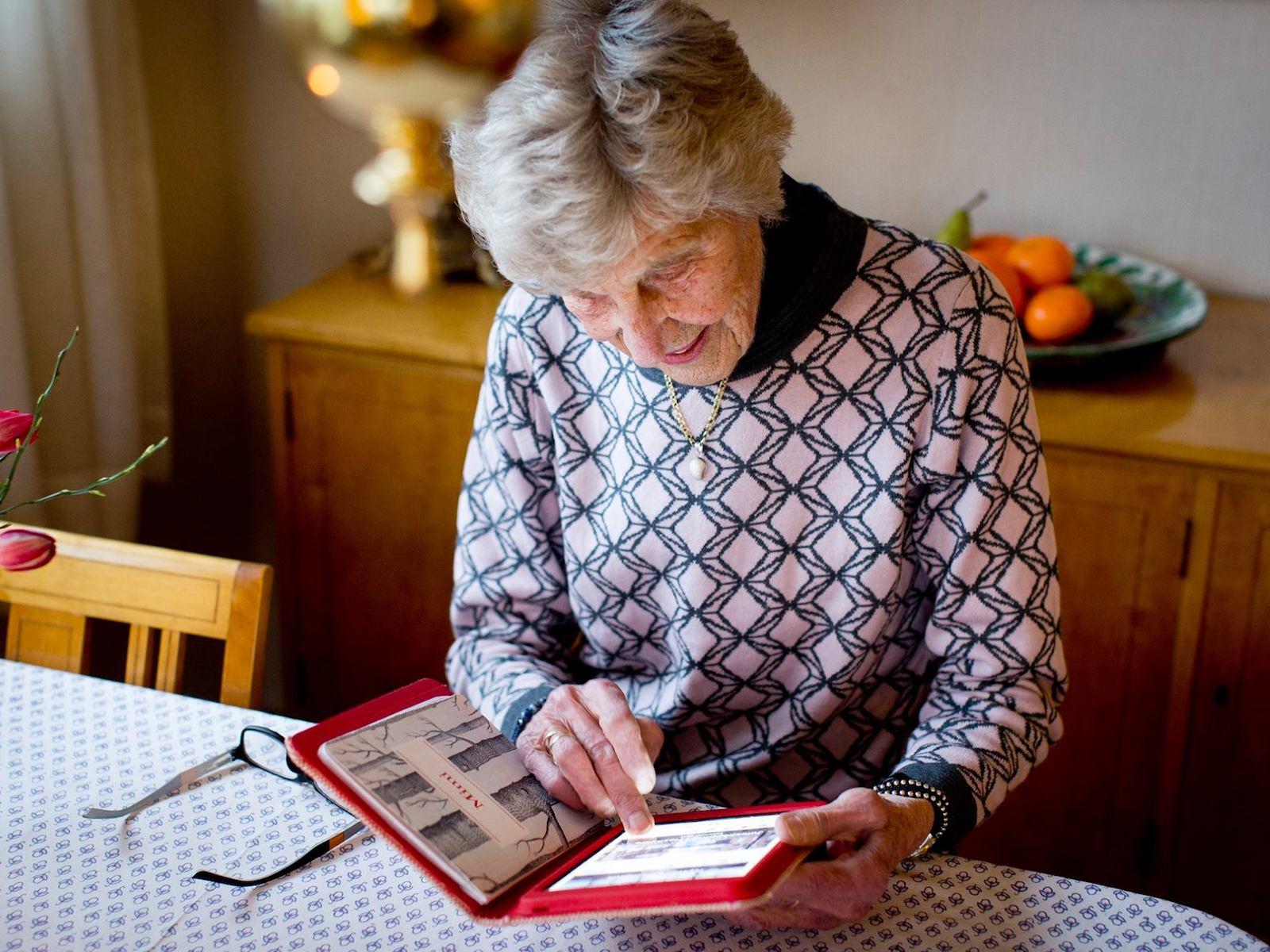 Grandma holding KAMA tablet